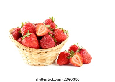 Strawberries in basket isolated on a white background