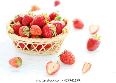 Strawberries in basket on blue wooden table