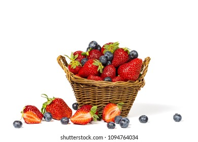 Strawberries with blueberries and basket isolated on a white background.