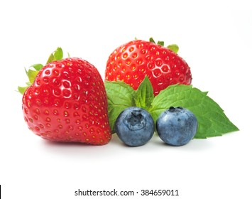 Strawberries, blueberries and mint leave, isolated on white. Forest fruits.