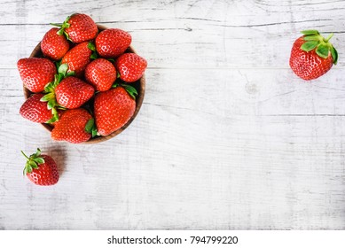 Strawberries in bow on white table top view. Beautiful red strawberry