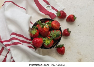 Strawberries in a bowl with a cloth