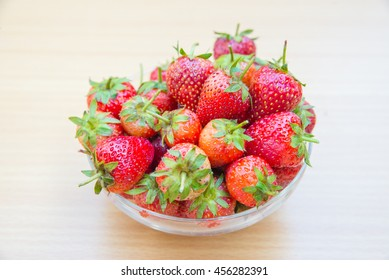 strawberries  in bowl on the wood background