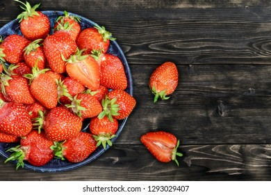 Strawberries in a bowl on a wooden table