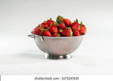 Strawberries bunch in metal strainer