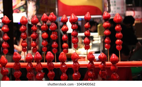 Strawberries in caramel, sold at a traditional night market in Taiwan