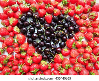 strawberries and cherries background in heart shape - summer diet, healthy eating, vitamins and healthy living