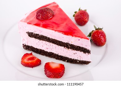 Strawberries and chocolate cake on the plate.