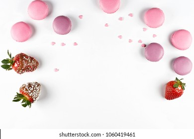 Strawberries in chocolate and macaron