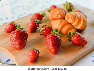 strawberries and croissants on the table