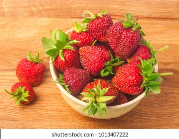 strawberries in Cup on wooden background