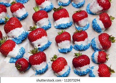 Strawberries dipped in white chocolate and marshmallow with blue sprinkles for the fourth of July. A creative treat with American colors.