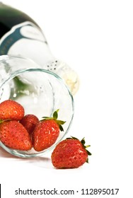 strawberries in a glass and champagne on the white background