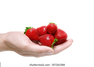 Strawberries in hand isolated on white background