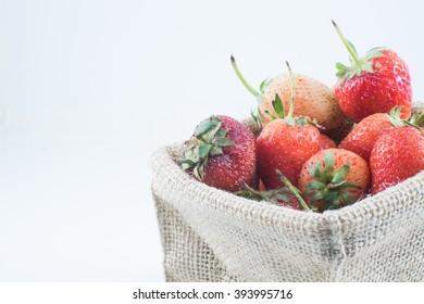 Strawberries in Hemp sack isolated on white background