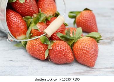 Strawberries lying on wood