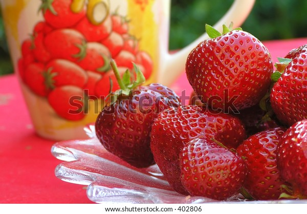 Strawberries on plate and with a strawberry mug too