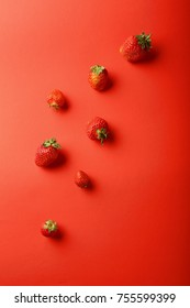 Strawberries on red background, food