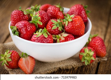 Strawberries on a vintage background as detailed close-up shot, selective focus
