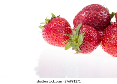 strawberries on white with reflection
