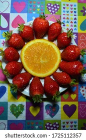Strawberries and oranges on a plate