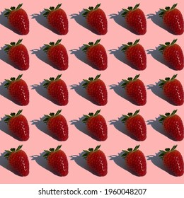 Strawberries pattern on a pink background.