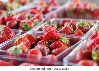 Strawberries at a produce stand.