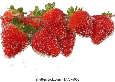 strawberries in sparkly water isolated on white