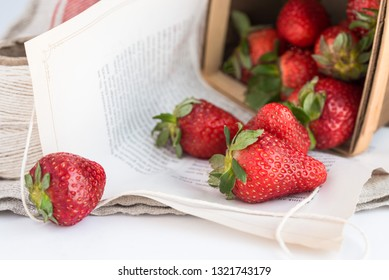 Strawberries spilled from berry box