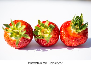 Strawberries strung, white background, fruity, red