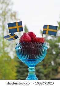 Strawberries with swedish flags. Celebration of Swedens National Day or Midsummer.