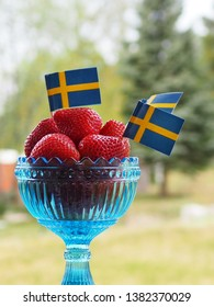 Strawberries and swedish flags. Celecration of Swedens National Day or Midsummer