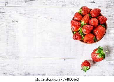 Strawberries top view. Strawberry on white table. Juicy red strawberry