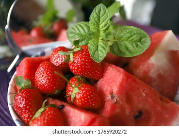 Strawberries, watermelon and mint for healthy eating. Red fruits for detox.
