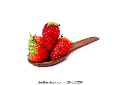 Strawberries with wooden spoon style isolated on white.