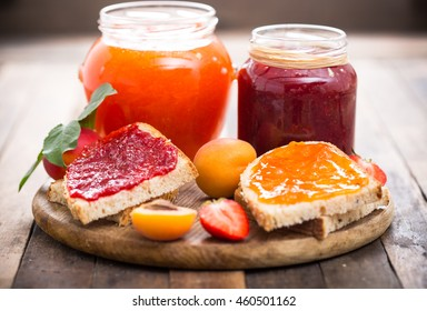 Strawberry and apricot jam on the bread
