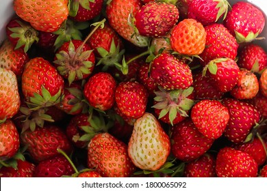 Strawberry background. Strawberries as pattern texture. Red sweet fresh strawberries as texture. Strawberry pattern as. Real imperfect. Selective focus