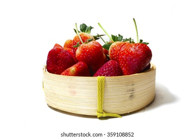 Strawberry in bamboo basket on white background
