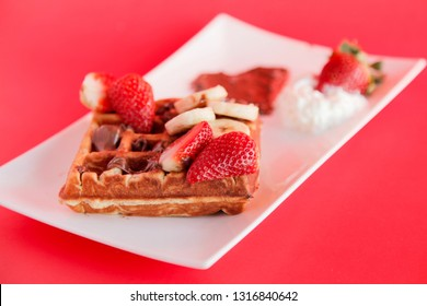 Strawberry and Banana flavour waffle with whipped cream and chocolate spread