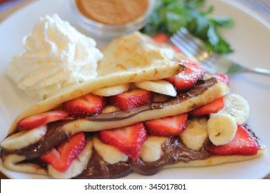 Strawberry Banana Nutella Crepe with Whipped Cream