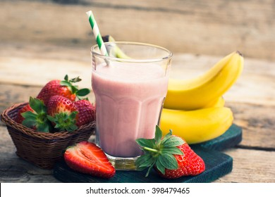 Strawberry and banana smoothie in the glass