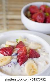 Strawberry and banana in yoghurt dessert