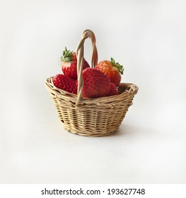 Strawberry in a basket, against white background