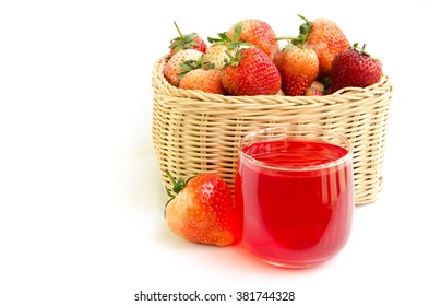 Strawberry in the basket and juice glass on white background