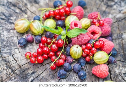 Strawberry berries. Beautiful, juicy, ripe berries on a wooden background.