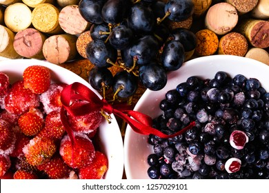 strawberry, blueberry, grape on wine corks, antioxidants, resveratrol flavonoids rich food