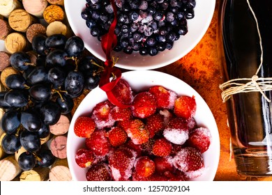 strawberry, blueberry, grapes on wine corks, red wine, antioxidants, resveratrol flavonoids rich food