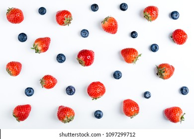Strawberry and blueberry on white background, top view. Berries pattern, flat lay. Strawberry and blueberry isolated on white background. Creative food concept