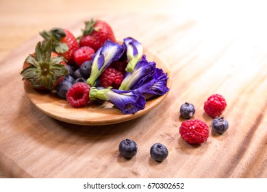 Strawberry, blueberry, pea blossom, raspberries on a butcher is a healthy food.