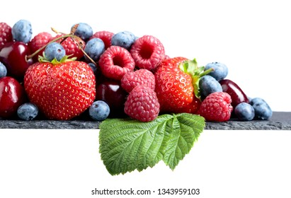 Strawberry, blueberry, raspberry and sweet cherry isolated on a white background.